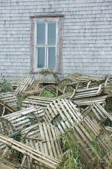Lobster traps behind the fish plant in Petit-de-Grat on Isle Madame.jpg